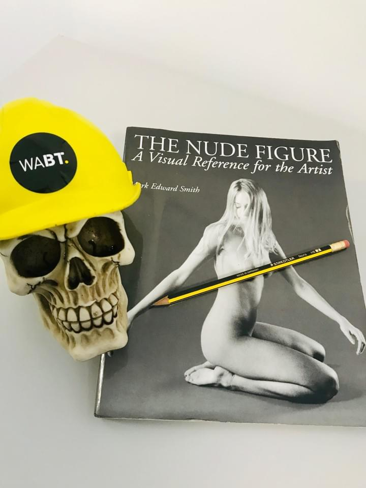 We Are Brass Tacks. Internal comms agency. Fred the Head. Book of the month. The Nude Figure. Skull with hard hat sitting on book. Yellow and black pencil on book