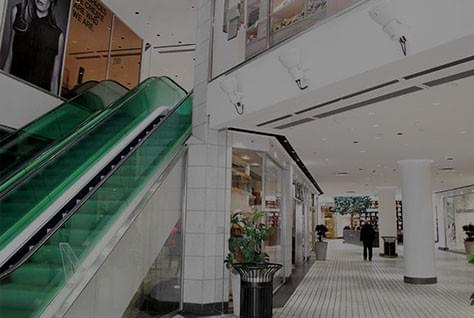A picture of a Mall that has a white flooring and walls.