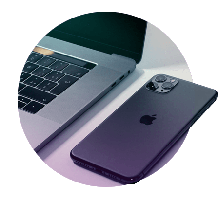 A picture of a sleek black I phone and a Laptop