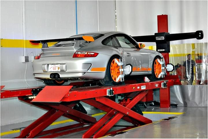 High performance sports car getting wheels aligned