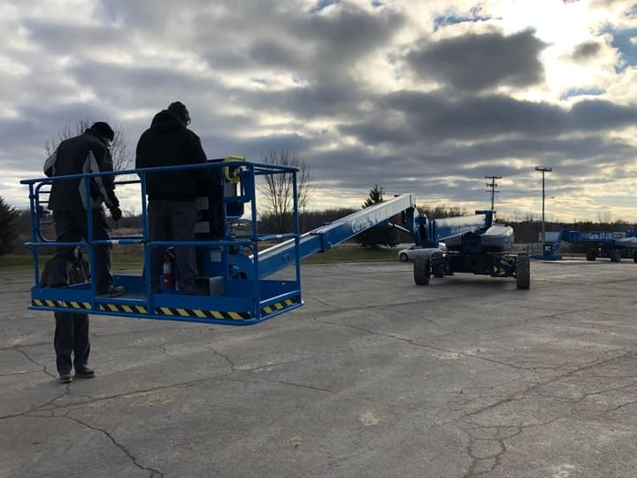 Mobile service on a Genie straight boom lift