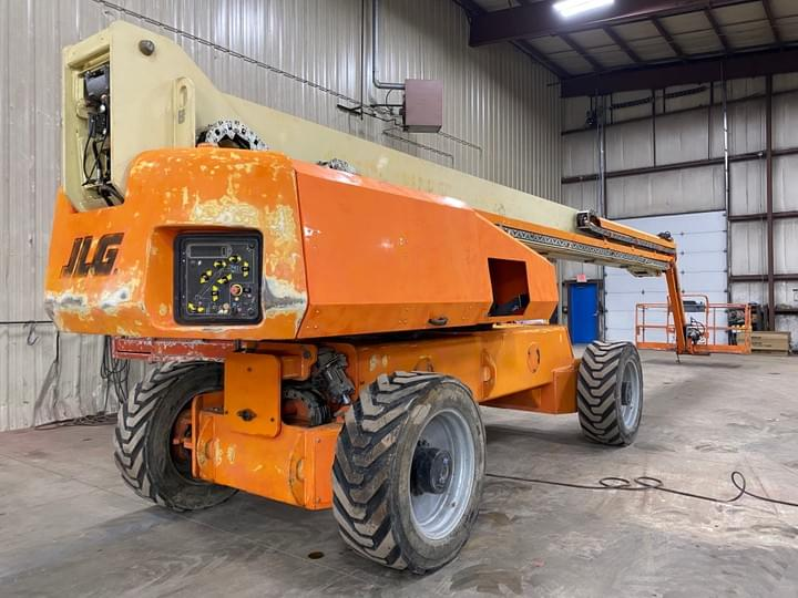 JLG 1350SJP that needed service work, repairs, and new paint and decals