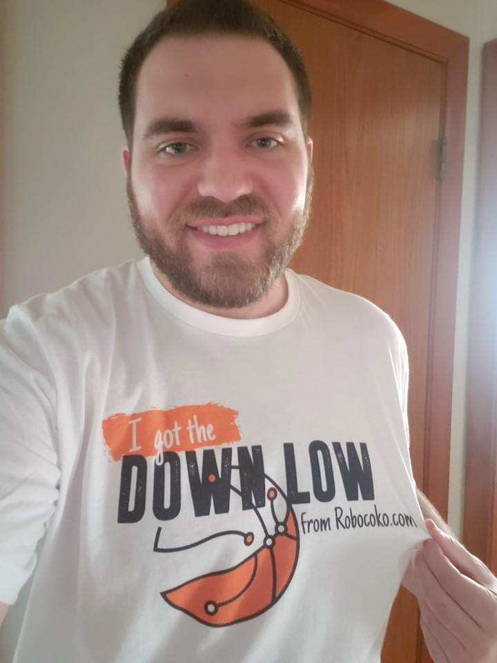 "Handsome bearded man wears T-shirt: ""I got the Down Low from Robocoko.com"""