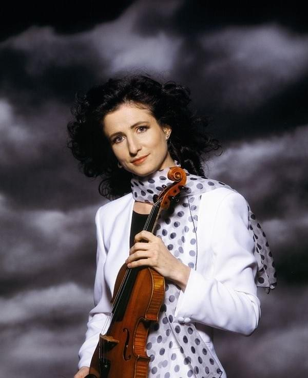 "Her performances as soloist and chamber musician in some 50 countries in a wide repertoire are frequently broadcast including the BBC Proms, ABC, Bayerischer Rundfunk and Italian TV. She has given recitals in venues including Lincoln Center New York, Wigmore and South Bank Centre London, Vienna, Moscow, Singapore and Sydney Opera House and with orchestras including the BBC National Orchestra of Wales, Royal Philharmonic, Czech Radio and St Petersburg Philharmonic. Mitchell's acclaimed discography for which she has been nominated for Grammy and BBCMusic Awards, includes works written for her by composers such Nyman and MacMillan and 'Violin Songs' (selected by Classic FM, including music from Paris in the 1920s) ""small gems, wonderfully played"" The Strad. She devised the Red Violin festival under Lord Menuhin's patronage, the first international eclectic celebration of the fiddle across the arts and has won awards for her original collaborations. She has also toured in Music Theatre productions such as L'Histoire du Soldat. Mitchell won the Tagore Gold Medal as Foundation Scholar at the Royal College of Music where she is a Professor and the prestigious Fulbright/ITT Fellowship to New York."