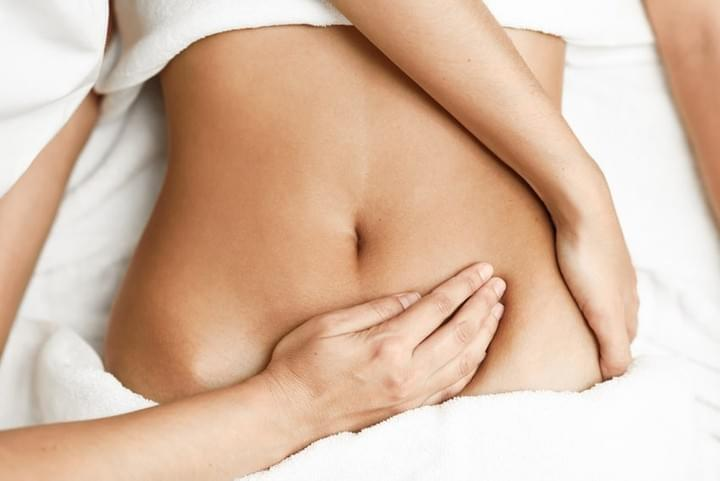 Woman Receiving Fertility Massage To Abdomen