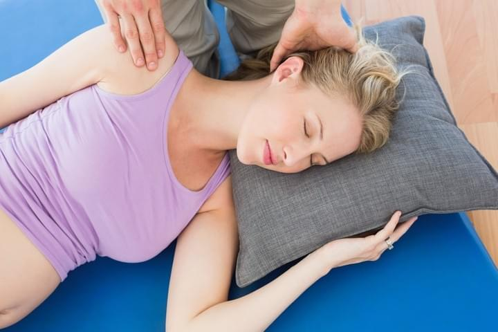 Pregnant  Woman Getting Massage In Side Laying Position