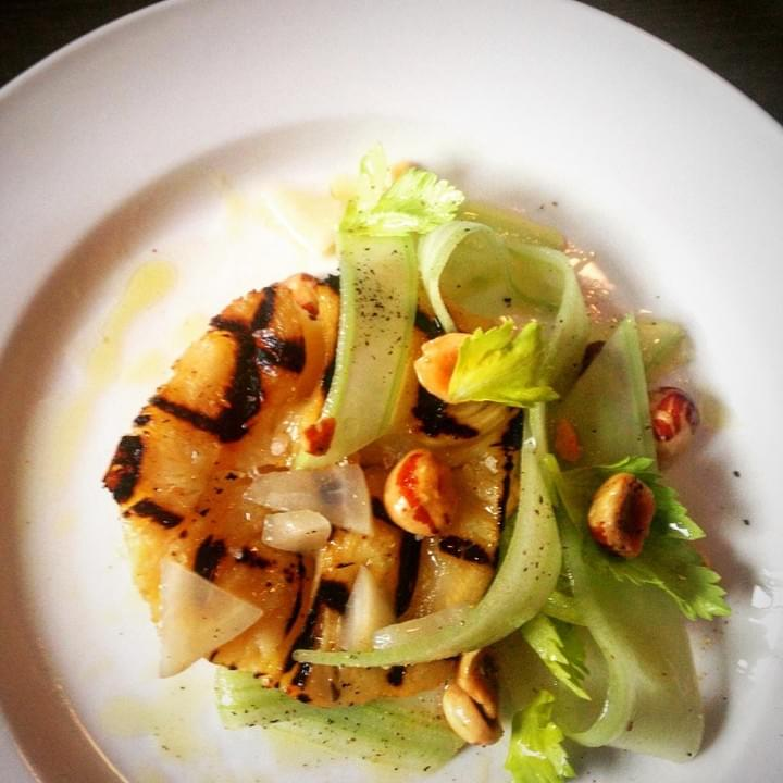 Grilled celery root with celery, pickled turnip and hazelnut salad