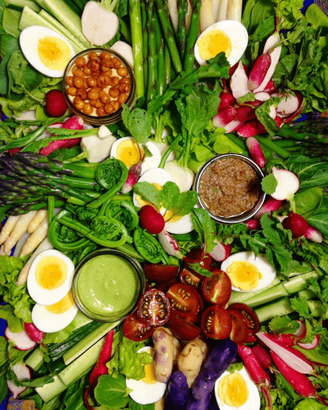 Spring vegetable basket with ramp green goddess dressing, chickpea and preserved lemon puree, and walnut bagna cauda