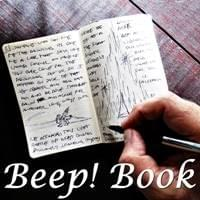 An open Beep! Book and a hand holding a pen over the paper