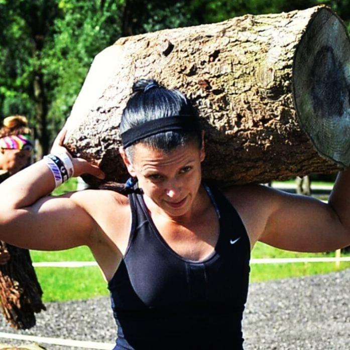 Cerys Cook, a competitive obstacle course racing athlete