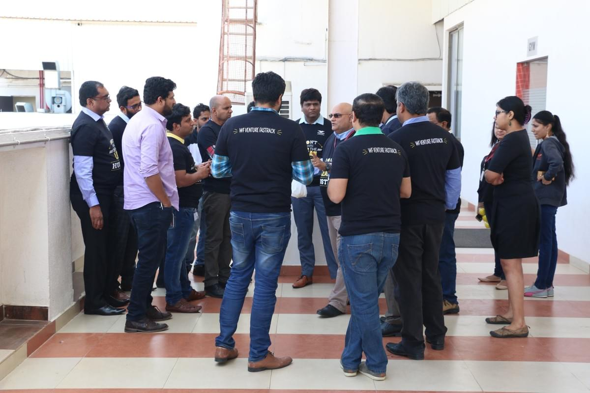 SCRUM Game with 2 teams, showing world beating time improvement.