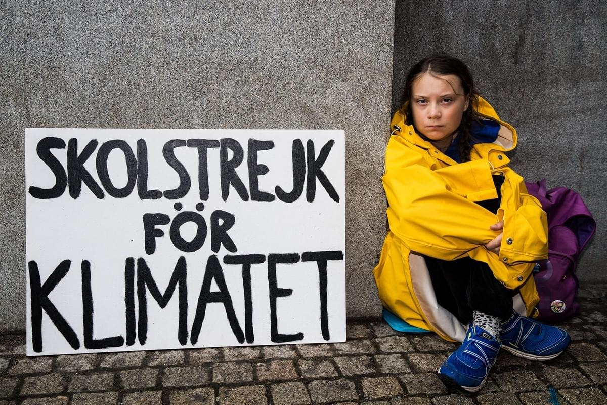 Greta Thunberg with School Strike for Climate banner outside Swedish parliament