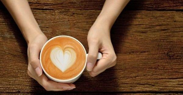 Sustainable coffee hands with a heart