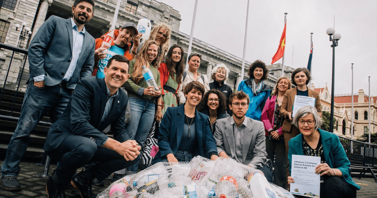 The Kiwi Bottle Drive delivering the petition at Parliament steps with politicians Environment Minister Eugenie Sage, (then) Wellington mayor Justin Lester, Green MPs Gareth Hughes and Chlöe Swarbrick.