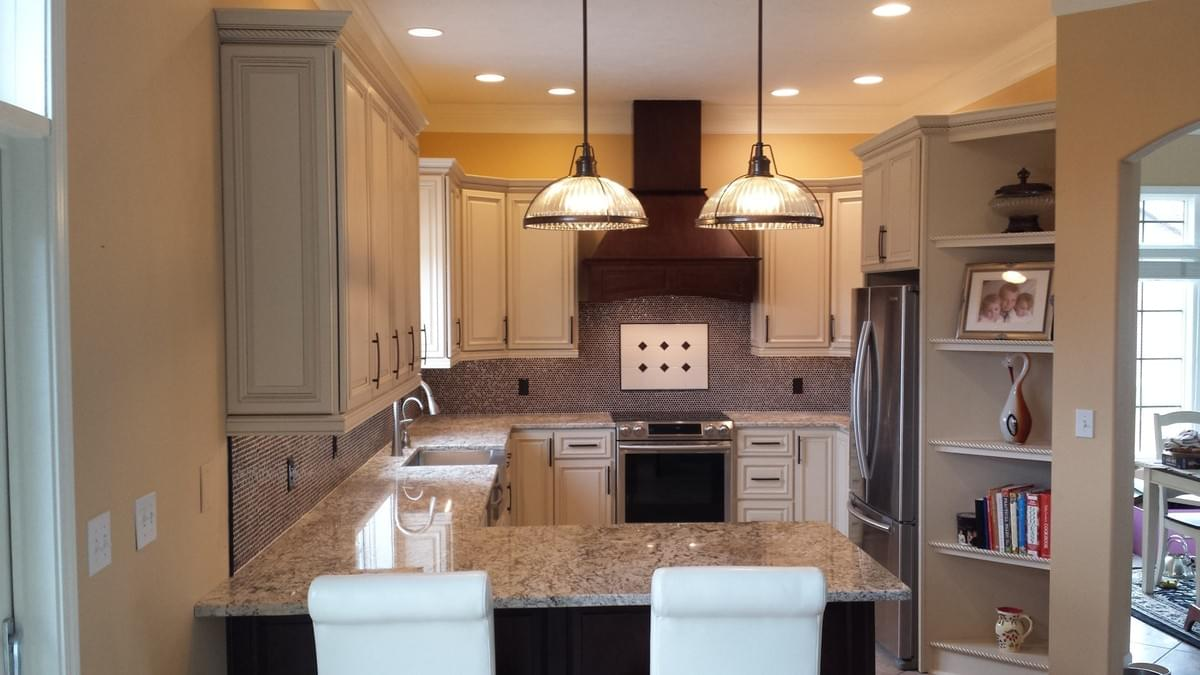 Traditional Cabinet Style, Wood Hood, Contrasting Peninsula, Undercabinet Lights