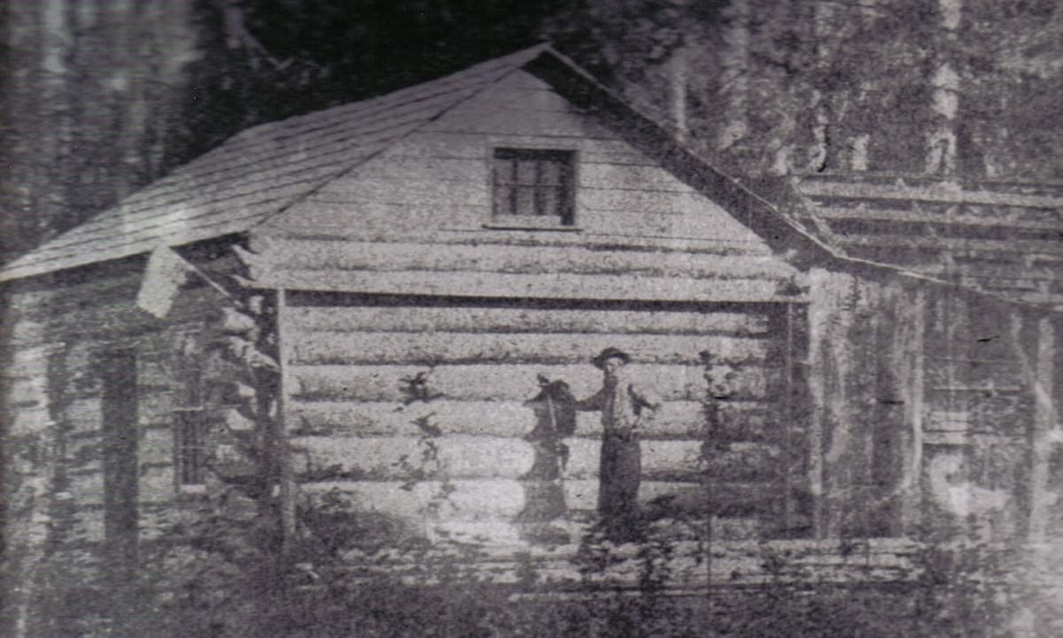 Job Carr in front of his log cabin, photographed by his son Anthony on 9/3/1866.