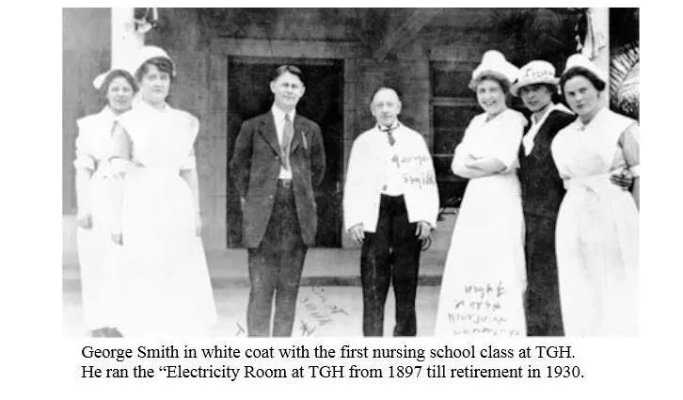 George Smith in white coat with the first nursing school class at Tacoma General Hospital.