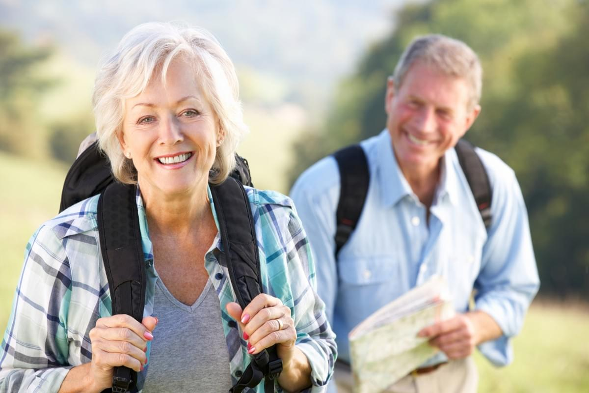 Happy Senior Couple Hiking Experiencing Pain Relief from Compounded Pain Medications