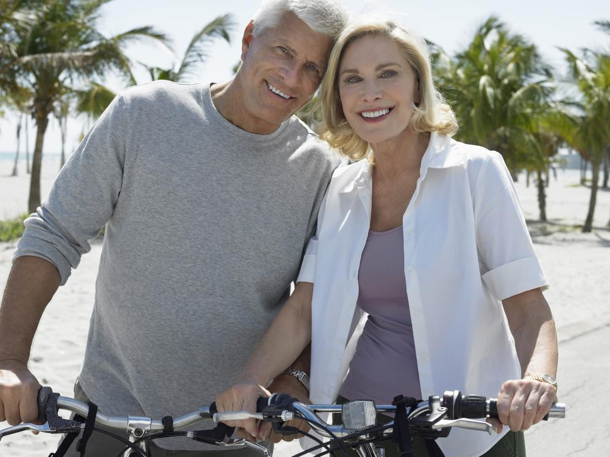Happy Middle Aged Couple on Bikes