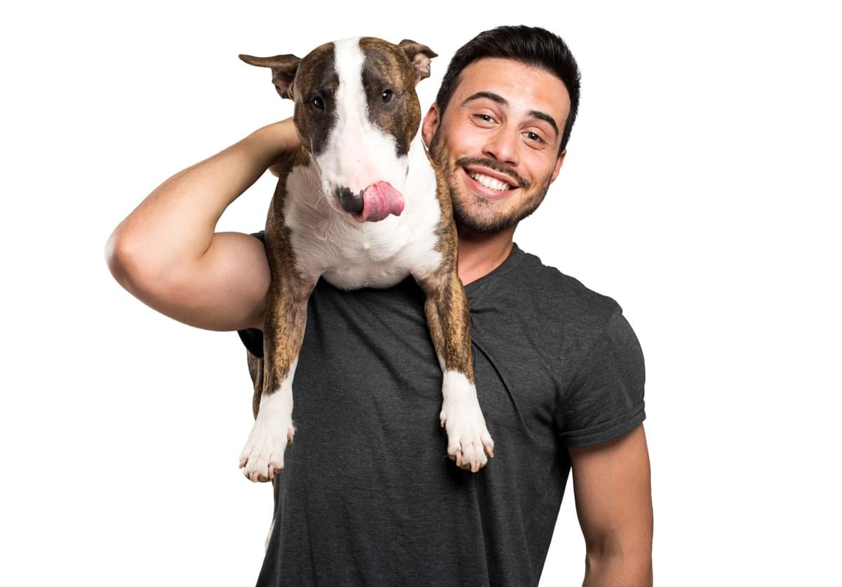 Man in 20s with Dog on Shoulder Happy Thinking about Compounded Pet Medications from InHealth Specialty Pharmacy Fargo, ND