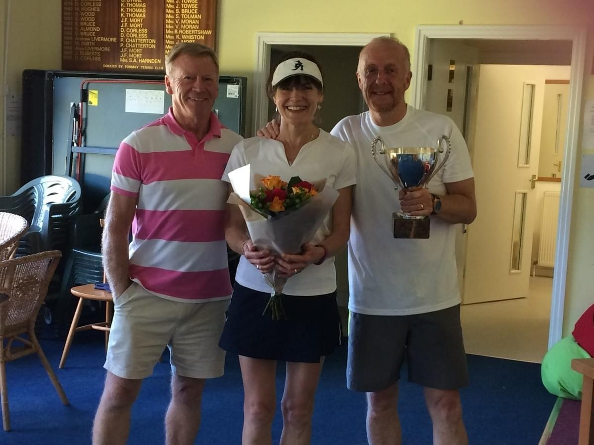 Formby Holy Trinity Tennis Club Captain John Langton, with Centenary Cup winners- Anne Girdler and Ian Davies from Southbank Tennis Club.