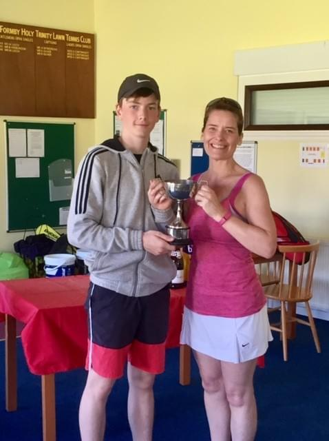Pictured: Ryan Smith and Lynn McGarry, holding the Harold Birt Trophy. FHTTC Formby Holy Trinity Tennis Club