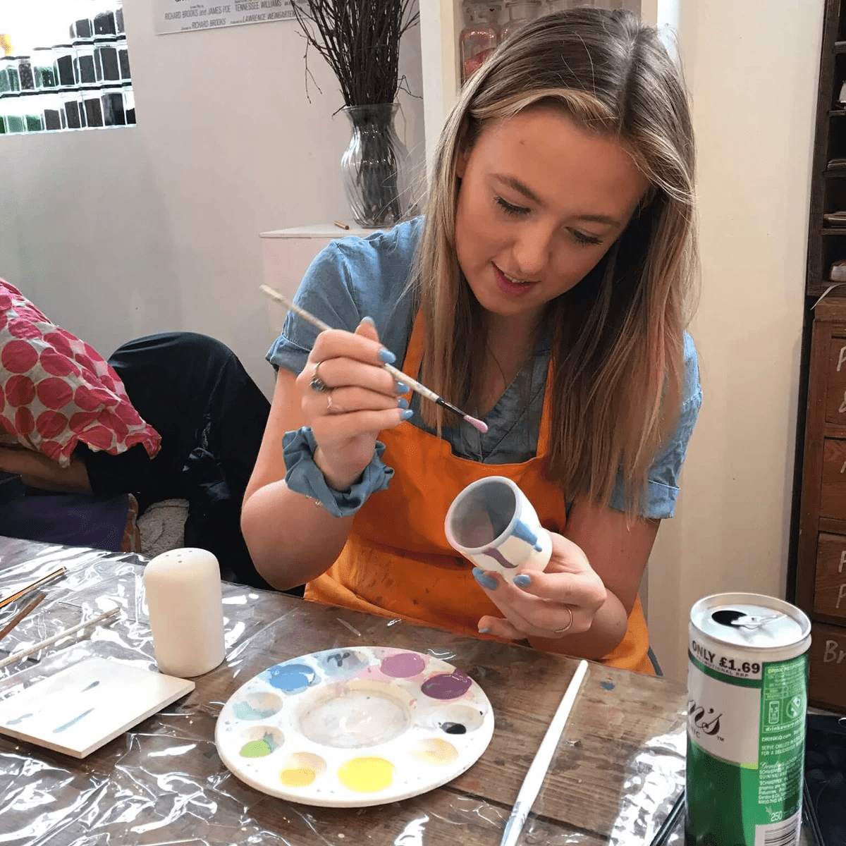 Kirsty's sister painting an egg cup