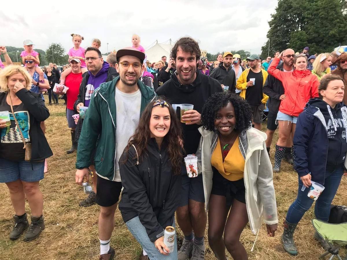 Tom, Kirsty, Sam and Diana in a field, smiling at the camera