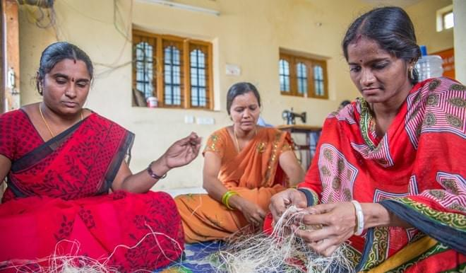 Women in India making reusable pads from banana fibre and cotton.
