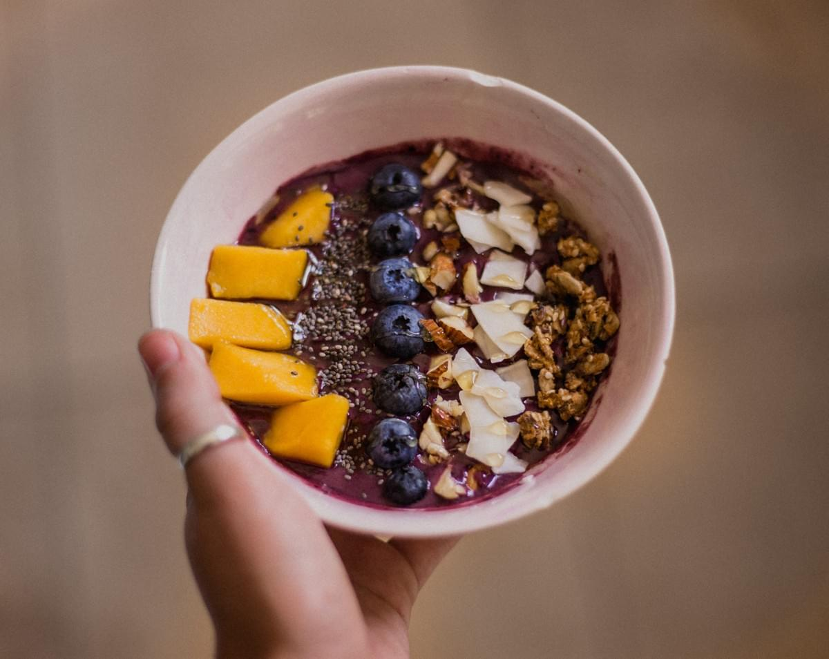 Smoothie bowl with fruit and granola topping