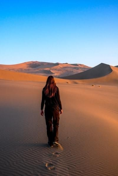 Image showing Nicole wandering in the desert near Dunhuang in China.