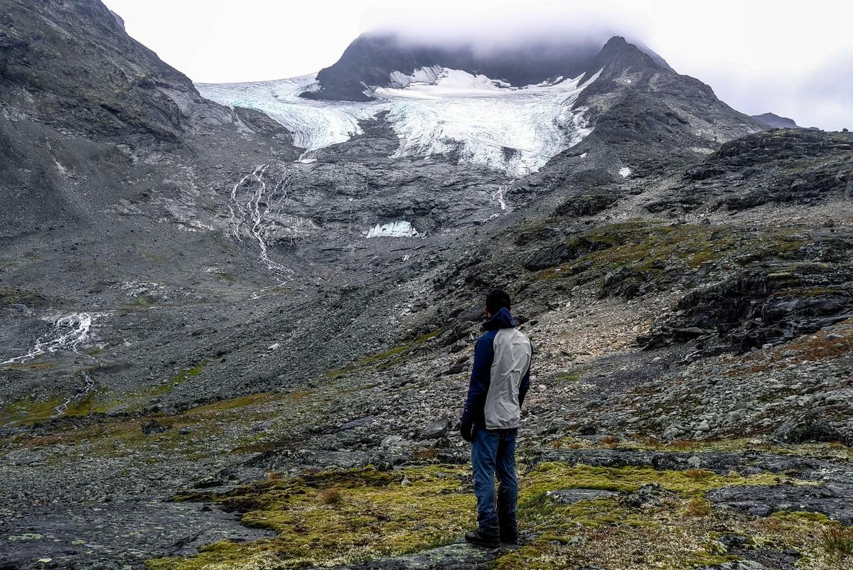 Image showing Kevin watching a glacier in Jotunheimen National Park, Norway.
