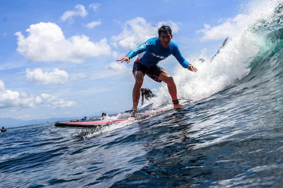 Image showing Kevin during a surf lesson with Pro Surf School at Serangan beach, Turtle Island on Bali, Indonesia.