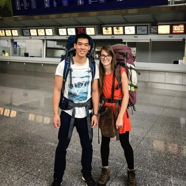 Image showing a young couple with heavy backpacks at the ariport.