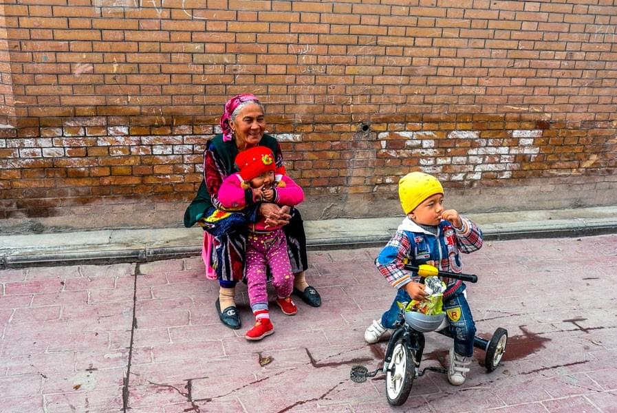 Image showing Uighur woman with her two kids in Kashgar, China.