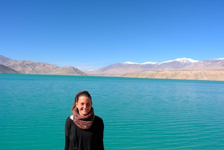Image showing Nicole at the Bulunkul lake in China, on her way from Kashgar to Tashkurgan.