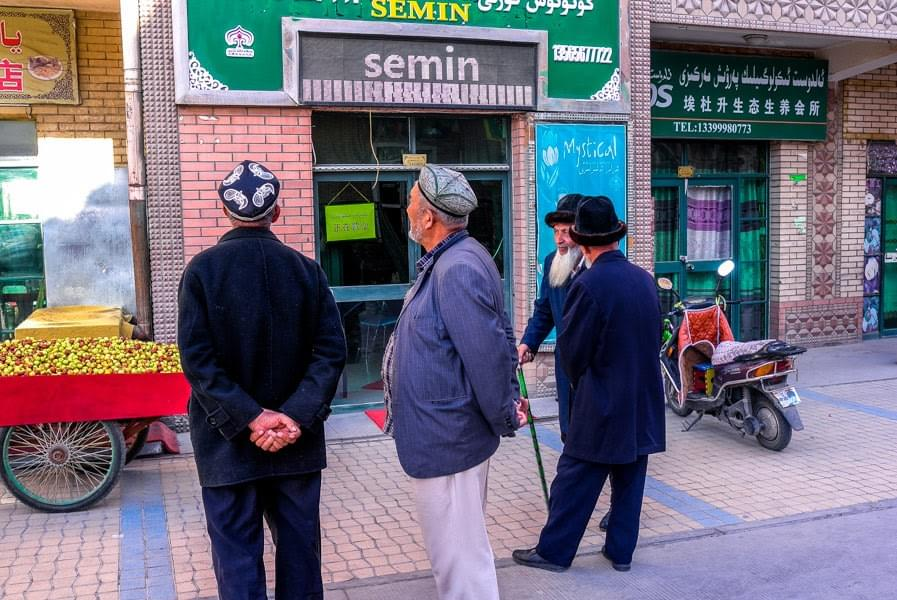 Image showing a group of Uighur men in the streets of Kashgar, China.