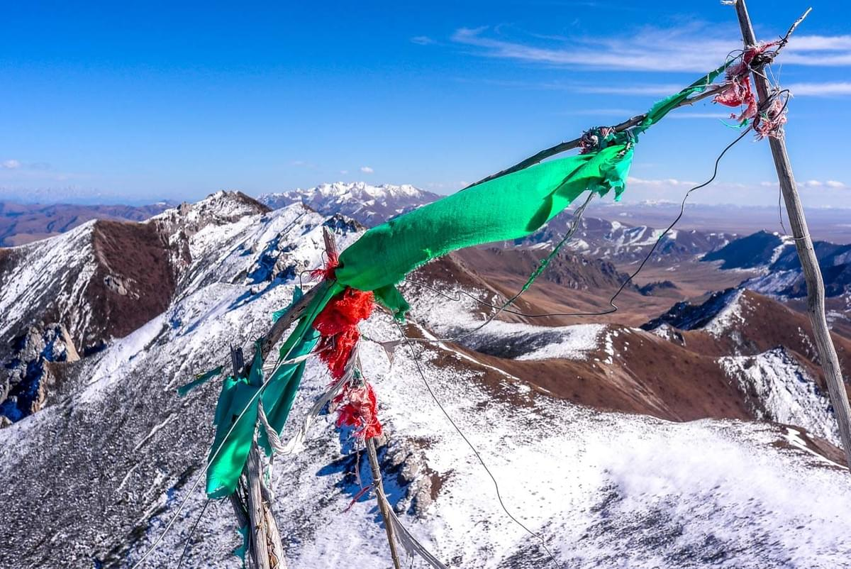 Image showing the mountain view from Mount Rixiema with colorful praying flags near Langmusi, China.