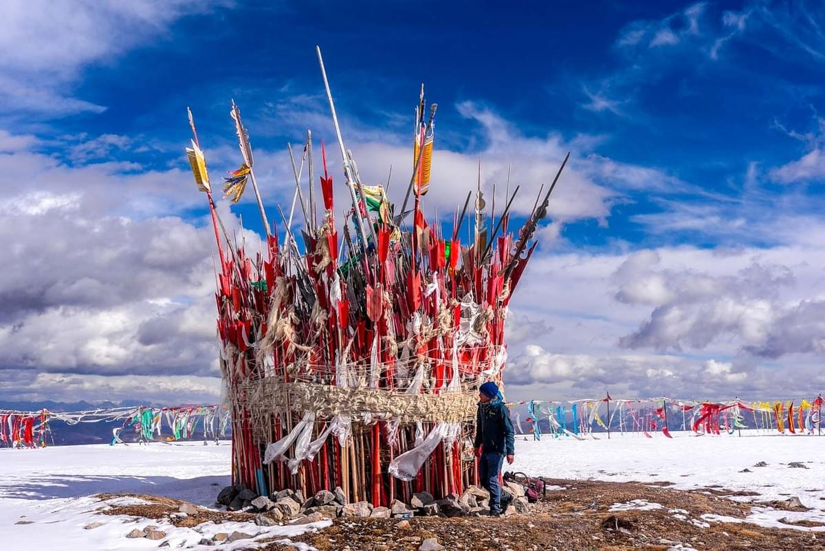 Image showing Tibetan flags on the peak of Mount Huagai, hiking in Langmusi.