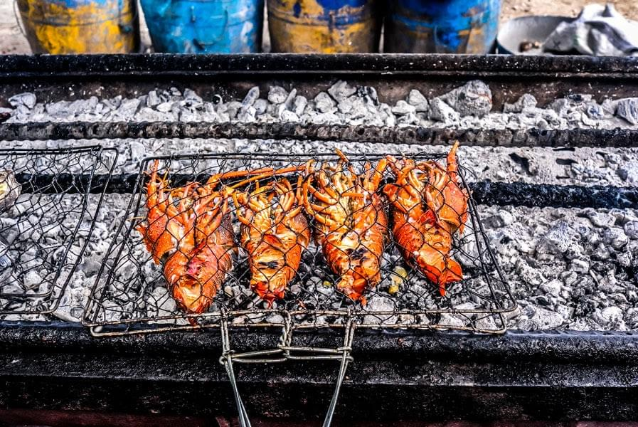 Image showing a barbecue fish Warung in Jimbaran, Bali, with lobsters on the grill.