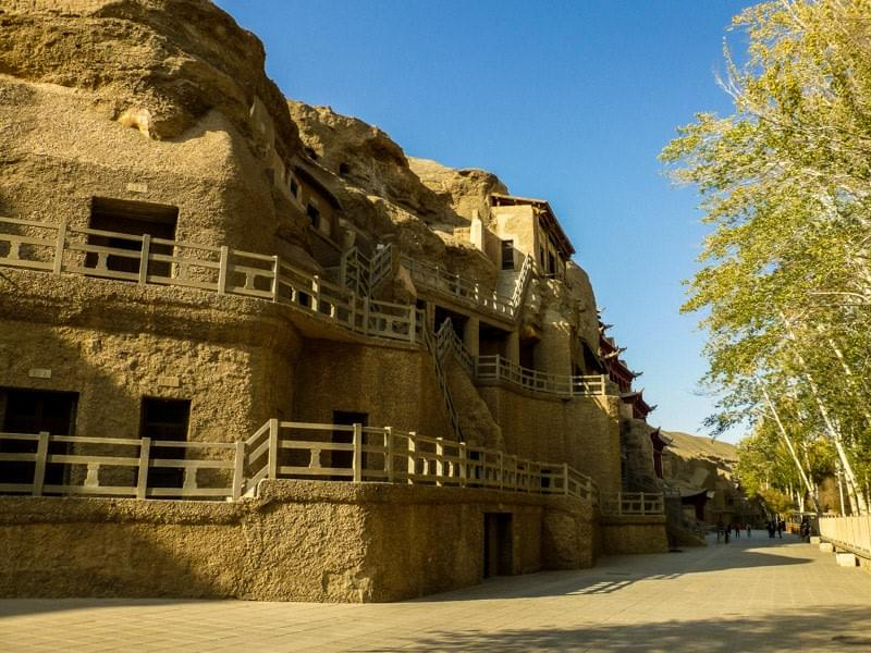 Image showing the Mogao caves, containing Buddhist art and statues, in Dunhuang, China.