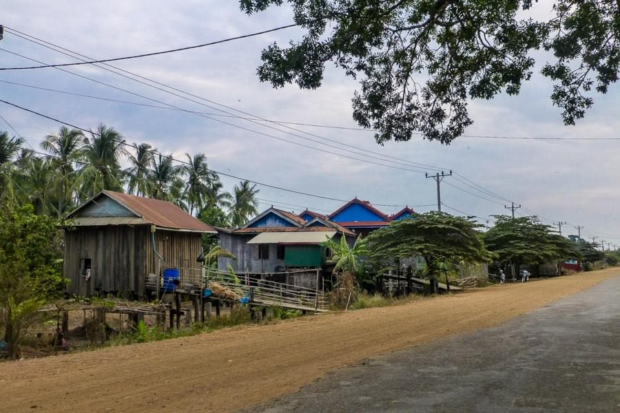 Image showing rural street with wooden houses on the way to see rare river dolphins in Kratie, Cambodia.