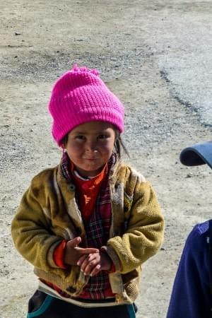 Image showing a small Tajik girl in Bulunkul during the Pamir Highway Roadtrip.