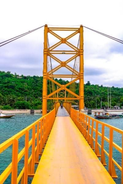Image showing the yellow suspension bridge connecting Nusa Lembongan and Nusa Ceningan.