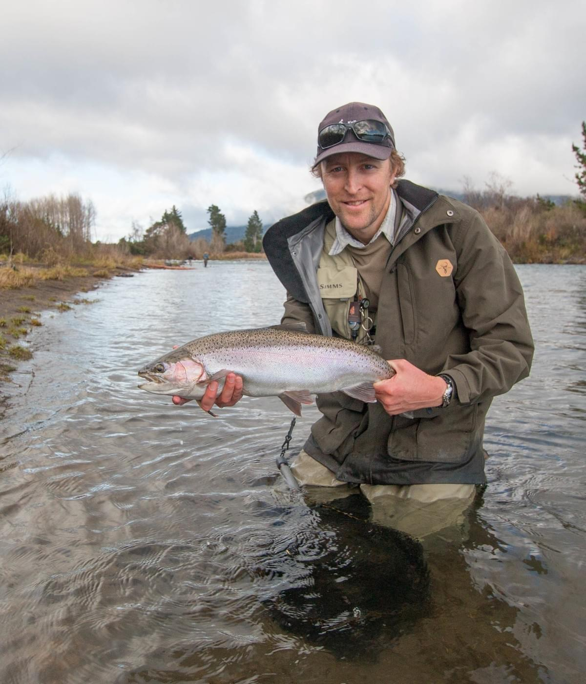 Solid spawning run rainbow displayed by Taupo, Tongariro river and Taranaki fly fishing guide Adam Priest.