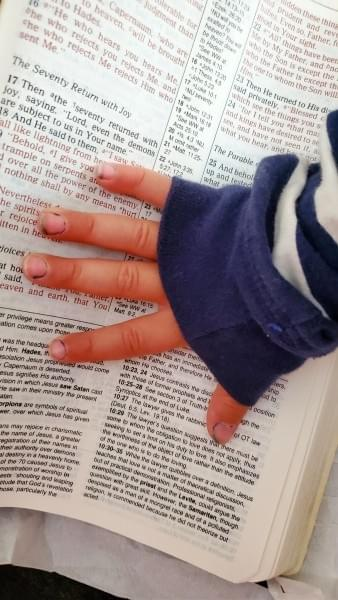 Child Hand on Grandma's Bible (c) Dena Michele Rosko 2020