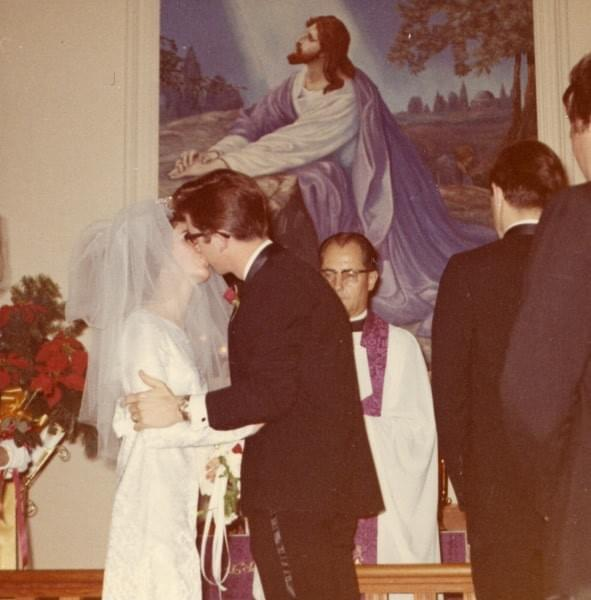 My parents' first kiss as husband + wife 1968