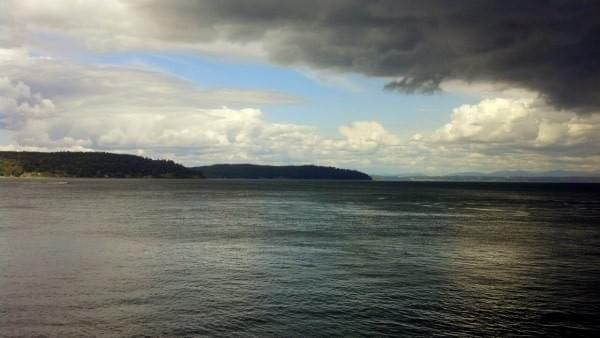 Opening in storm clouds via Pt. Defiance Marina, Tacoma, Wash.