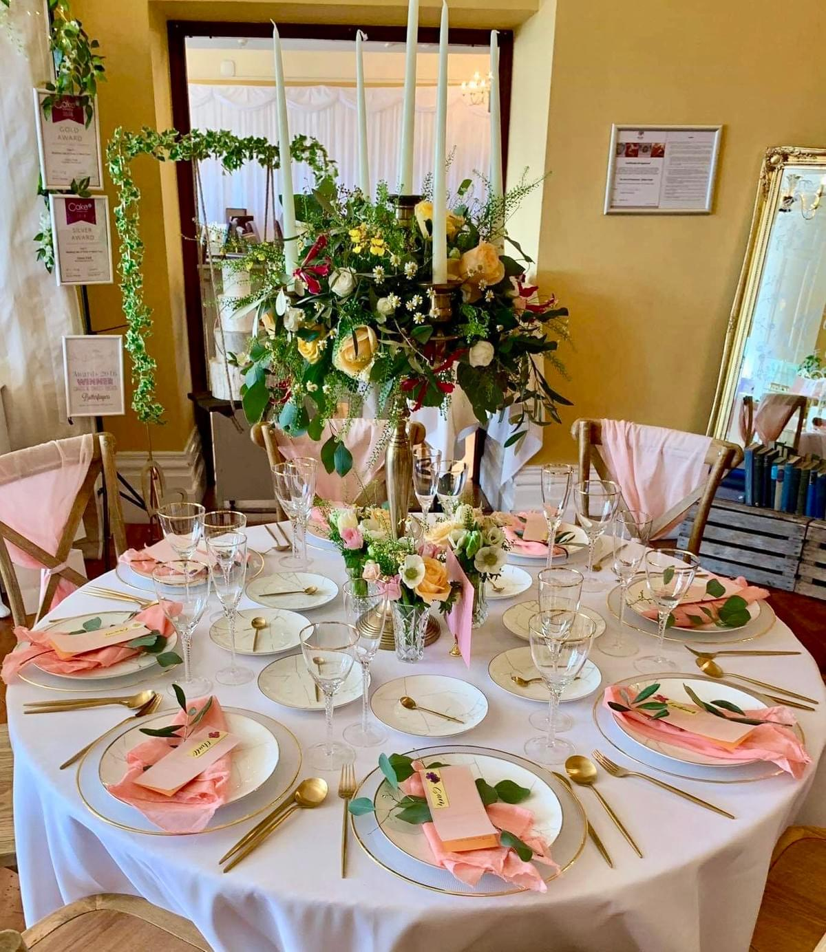 Living coral table styling, gold cutlery, gold candelabra, brush lettering, calligraphy
