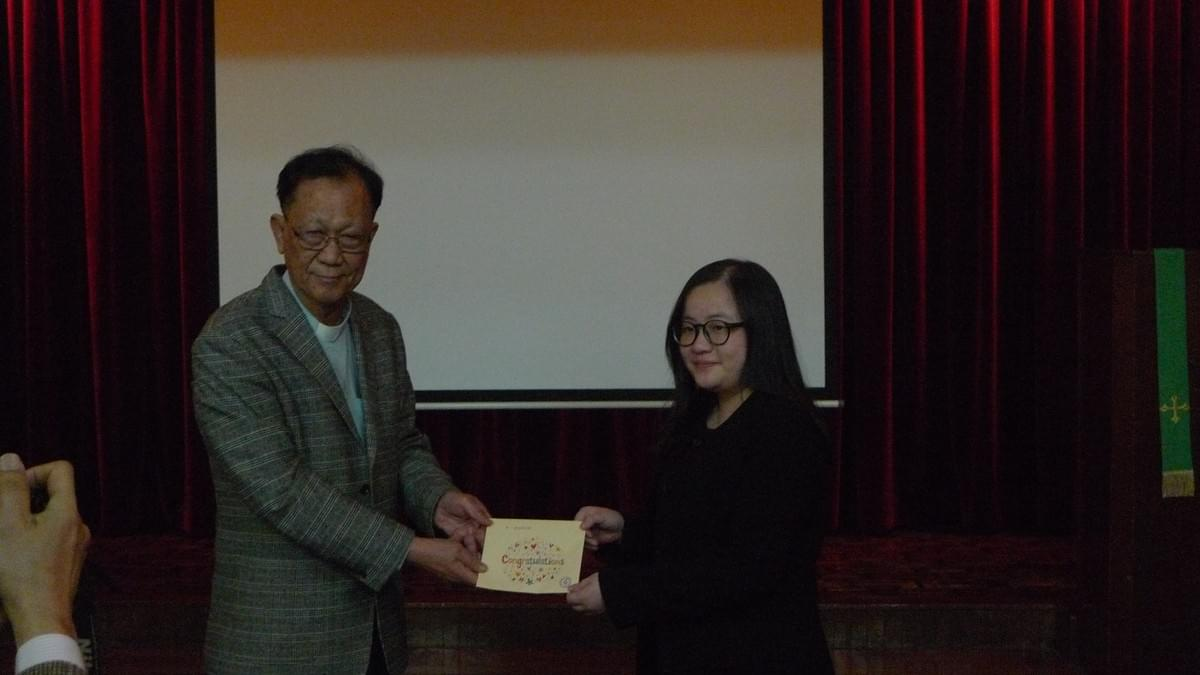 Dr. IP Awarding the Scholarship to Ms. Winter CHOI